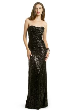 This gown is classic, but the beading adds a modern dimension to it.