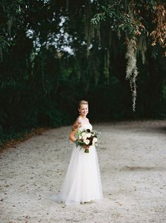 Photography : Kyle John Photography | Wedding Dress : BHLDN Read More on SMP: http://www.stylemepretty.com/2016/01/29/destination-charleston-wedding-with-a-contemporary-vibe/