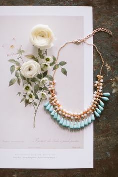 A statement necklace in a spring hue.