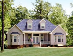 <ul><li>The formal balance of the exterior of this affordable country-style design is most appealing. If desired, a…