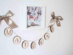 A personal favorite from my Etsy shop https://www.etsy.com/listing/530931391/wood-slice-garland-name-garland-monogram
