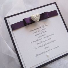 Postcard style wedding invitation using silver filigree heart and contemporary folded bow