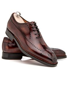 Bontoni Legno Scuro Sciuscia 	Legno scuro oxford 	5 eyelet oxford 	Perforated toe medallion and side 	Leather lining and insole 	Cushioned footbed 	Rounded square toe 	Norweigean welt stitching 	Hand stitched apron 	Tonal top stitching 	Shoe trees included 	Color: Legno scuro 	Handmade in Italy