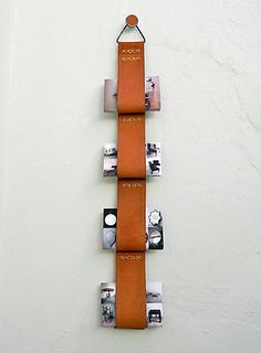 Hanging wall organization system. Working with the natural gravitational tendency of leather and it's allowances. - Katy