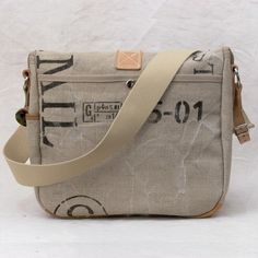 This Messenger Bag, emulates a model of an US-army bag from 1943, its made from recycled leather, and a recycled military-postbag, heavy cotton/linen mix. with a handprinted imprint. This bag includes 7 pockets ! Inside there are two useful slip-pockets. Outside there is one pocket at the backside and a small pocket on the right side fg. for i-phone,. Frontside there 3 pockets one with a zip ( under the flap ), the two small ones (left and right) got push buttons.  * Outside: recycled le...
