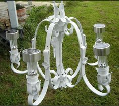 Out door chandelier made with solar lights. Interesting idea, but I'd want to find some prettier solar lights. Solar Light Chandelier, Outdoor Chandelier, Solar Lights, Chandelier Tree, Chandelier Ideas, White Chandelier, Vintage Chandelier, Shabby Chic Dining, Cool Diy Projects