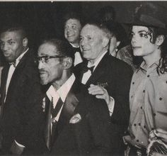 Mike Tyson, Sammy Davis, Jr., Frank Sinatra, and Michael Jackson. This is a one of a kind photo.