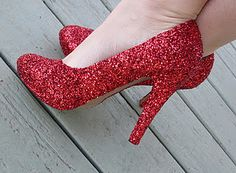 DIY glitter heels. Just use Mod Podge, glitter, and acrylic spray to transform an old pair of shoes