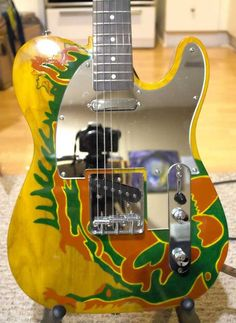 """Jimmy Page's 1959 Fender """"Dragon Telecaster"""" •Artistically creative, hand painted and transformed ... into a once treasured masterpiece by Page himself. This guitar was originally a '59 Blonde"""" Fender Telecaster which was battered and passed down from owner Jeff Beck to Jimmy, while in The Yardbirds. Jimmy Page performed with this guitar in The Yardbirds, as well as, for a brief period in Led Zeppelin. While Jimmy was away, a friend decided to surprise him and painted over his prized Dragon"""
