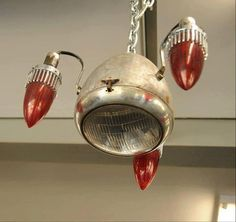 cool use of old parts for a light in a room.