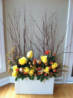 Arrange flowers with other organic elements for a casual yet elegant piece.