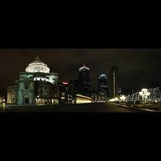 A panorama of The First Church of Christ, Scientist (The Mother Church of Christian Science) in Boston, Massachusetts, USA. This is world headquarters for the Church of Christ, Scientist and has members from over 130 countries. This church has one big pool in the middle of the photo that usually reflects the lighting of its surroundings but, unfortunately, it was drained out for safety during winter.  I took this photo today December 23, 2012 around 7:30 PM, one day before Christmas Eve.