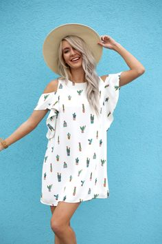Cold shoulder dress + cactus print = a dream come true! Catch this unique flowy white cactus dress now!