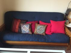 This futon frame is in full size with thin arm rests in honey finish.  Unfortunately this is the cheap type of futon mattress.  Notice how it's thin and flimsy and uneven in certain areas.