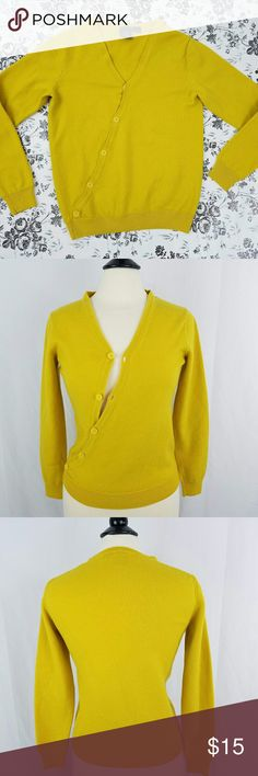 Armani Exchange Cross Heart Button Wool Sweater XS Gorgeous sweater from Armani Xchange in size XS Bright Mustard yellow color, very trendy this winter Buttoned  V Neck Wool blend Perfect pre owned condition, normal piling but still looks perfect! Armani Exchange Sweaters V-Necks