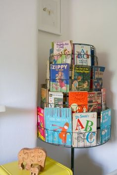 I LOVE this idea for B's room! Cute book idea for the home - a revolving shoe rack becomes a revolving book holder easy for kids to look at each book before choosing what they want. AND easy for the kids to put the books back Revolving Shoe Rack, Spearmint Baby, Deco Kids, Kids Library, Book Racks, Book Holders, Kid Spaces, Kids Decor, Boy Room