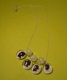 Silhouette glass bead necklace... also can make magnets out of these