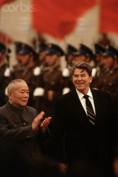 A leader in the Chinese government (left) applauds President Ronald Reagan during the arrival ceremony in honor of the Reagans' 1984 state visit to the People's Republic of China. April 01, 1984, Beijing, China