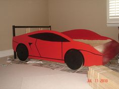 Materials: Fjellse full size bed frame Description: My 3 year old son wanted a race car bed, but we needed at least a full size for his large bedroom. Ikea Kura Bed, Car Bedroom, Kids Bedroom, Bedroom Decor, Race Car Bed, Race Cars, Kids Car Bed, Diy Bett, Child Room