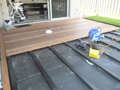 How to Lay Deck Flooring on a Concrete Patio | Laying decking ...