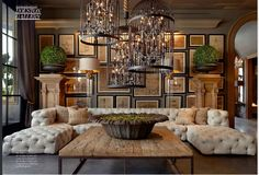Incredible cage chandeliers. Restoration Hardware's got color.