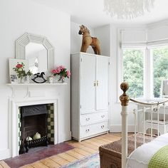 White bedroom with traditional fireplace | Bedroom decorating | 25 Beautiful Homes | Housetohome.co.uk