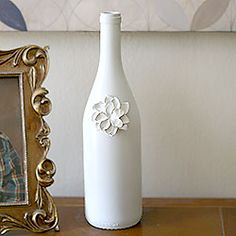Upcycled wine bottles with clay flowers
