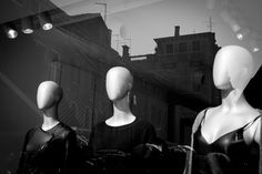 a street photography in Venice mannequins in the city
