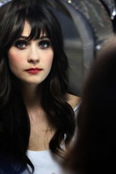 zooey deschanel. my mother looks just like her..