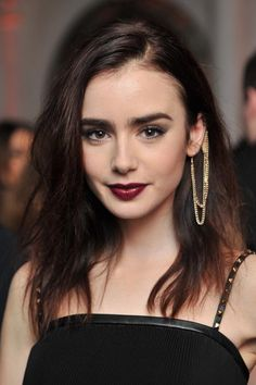 #Inspiration #LillyCollins #Makeup #Style #BlackDress #BiographyTrend #MagicForest #BiographyCollection #Biography