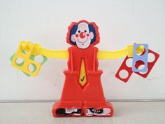 Numicon and a balancing clown helps children to see equivalence/same as: 3+4=2+5 Also great for developing mathematical language.