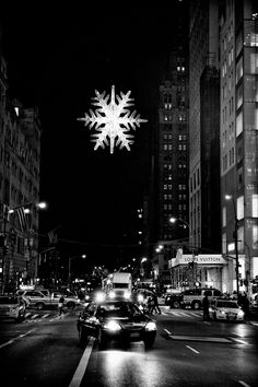 Black and white photograph of the star/snowflake that hangs above the intersection of 57th Street and Fifth Avenue during the Holiday Season