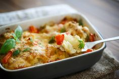 If you're tired of the same old mashed potato sides, then this recipe is for you! Roughly mashed cauliflower baked with cheese and fresh seasonings will be the talk of the dinner table and it's perfect for your holiday meals and dinner parties. Baked Cauliflower Casserole, Cauliflower Mashed Potatoes, Veggie Dishes, Vegetable Recipes, Potato Sides, Low Carb Side Dishes, Thanksgiving Recipes, Penne, Macaroni And Cheese