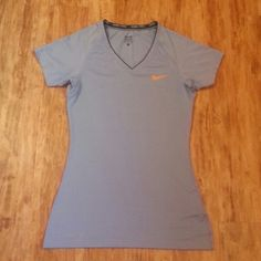 *PRICE CUT* Nike Pro * t-shirt & shorts Light blue, Dri-Fit workout t-shirt. Black workout shorts with slit around the waistline at the back (not Nike) Fabric on shorts is spandex. Both are size small.  T-shirt used once and shorts used three times.( I cut off the tag on the inside of shorts as it was a bit uncomfortable when doing floor exercises.)  Selling both together! Nike Tops Tees - Short Sleeve