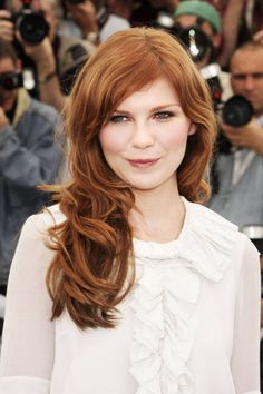 Famous Actress Kirsten Dunst From Marie Antoinette Movie Wearing Her  Banged-Face-Framed Layered  Red-Side-swept Hairdo.