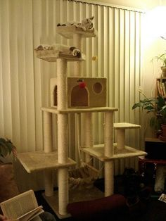 Large Cat Tree. This cat tree looks nicely balanced and very solid. It looks like it would be quite difficult to tip over. Sturdiness is the most important consideration when making cat trees.