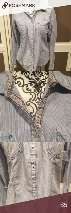 Blue and White stripe shirt This shirt has tiny blue and white stripes with an adorable flower print on the inside of the collar and other side of the buttons. It's only been worn a few times and is in excellent condition.  I also offer 25% off bundles of 2 or more, so check out the rest of my closet to bundle and save😊. Maurices Tops Button Down Shirts