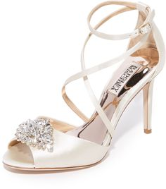 a737a9f60473 tatum peep toe sandals by Badgley Mischka. A sparkling crystal brooch  accents the peep toe on these elegant satin Badgley Mischka sandals.