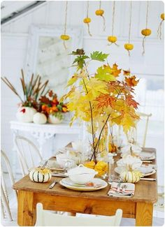 the presence of autumn flair. Leaves, gourds, and miniature pumpkins create a pretty fall tablescape.