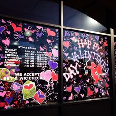 L❤️VE is in the air! Valentine's Day window painting.