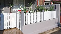 Build a classy picket fence for an amazing front of house makeover.