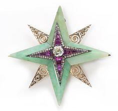 A jadeite jade, ruby and diamond star brooch