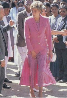 1993:  Princess Diana in Nepal wearing pink pleated skirt w/ black polka dots and pink jacket by Paul Costelloe.