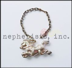 Vintage Hermes horse solid sterling silver keychain or bag charm. Excellent condition with normal wear.