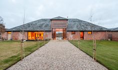 David Nossiter Architects breathed new life into a collection of decrepit farm buildings, transforming them into the energy-efficient Church Hill Barn house.