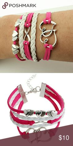 NWT Leather Bracelet Hot pink and white heart leather bracelet. Has an adjustable clasp for a better fit! Jewelry Bracelets