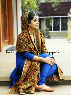 Phulkari dupatta with any contrasting Colour suit. (Not these dupatta and suit colours, not a long sleeved kameez)