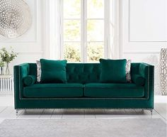 The New York Velvet 4 Seater Sofa is comfortable and stylish. Upholstered in green velvet, the large sofa features a tufted button design and metal stud detailing. Complete with 2 bolster cushions and 2 classic cushions, the large sofa is also available i Green Velvet Armchair, Velvet Chaise Lounge, Green Sofa, Bedroom Sofa, Living Room Sofa, Bedroom Decor, Traditional Cushions, Oak Furniture Superstore, Mismatched Furniture
