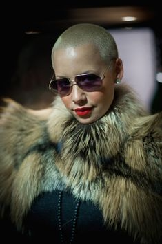 Amber Rose Red Lipstick - Amber Rose topped off her fur clad look with gold stunner shades and hot red lipstick. Hot Red Lipstick, Red Lipsticks, Kanye West, Amber Rose Hair, Amber Rose Photo, Shaved Head Women, Shaved Heads, Black Chyna, Revealing Swimsuits