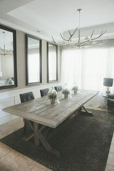This gorgeous 108 inch trestle table was handmade and finished with a gray and Jacobean stain combined with a gray wash. Bread boards are a